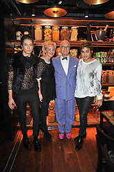 Left to right, TOMAS AUKSAS, AMANDA ELIASCH, MANOLO BLAHNIK and PABLO GANGULI at a dinner in honour of Andre Leon Talley and Manolo Blahnik held at The Spice Market restaurant at W London, Leicester Square, London on 14th March 2011.