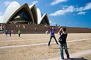 Tourists taking photographs at Sydney Opera House,  New South Wales, Australia