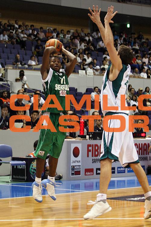DESCRIZIONE : Sapporo Giappone Japan Men World Championship 2006 Campionati Mondiali Slovenia-Senegal <br /> GIOCATORE : Aw <br /> SQUADRA : Senegal <br /> EVENTO : Sapporo Giappone Japan Men World Championship 2006 Campionato Mondiale Slovenia-Senegal <br /> GARA : Slovenia Senegal <br /> DATA : 19/08/2006 <br /> CATEGORIA : Tiro <br /> SPORT : Pallacanestro <br /> AUTORE : Agenzia Ciamillo-Castoria/G.Ciamillo <br /> Galleria : Japan World Championship 2006 <br /> Fotonotizia : Sapporo Giappone Japan Men World Championship 2006 Campionati Mondiali Slovenia-Senegal <br /> Predefinita :