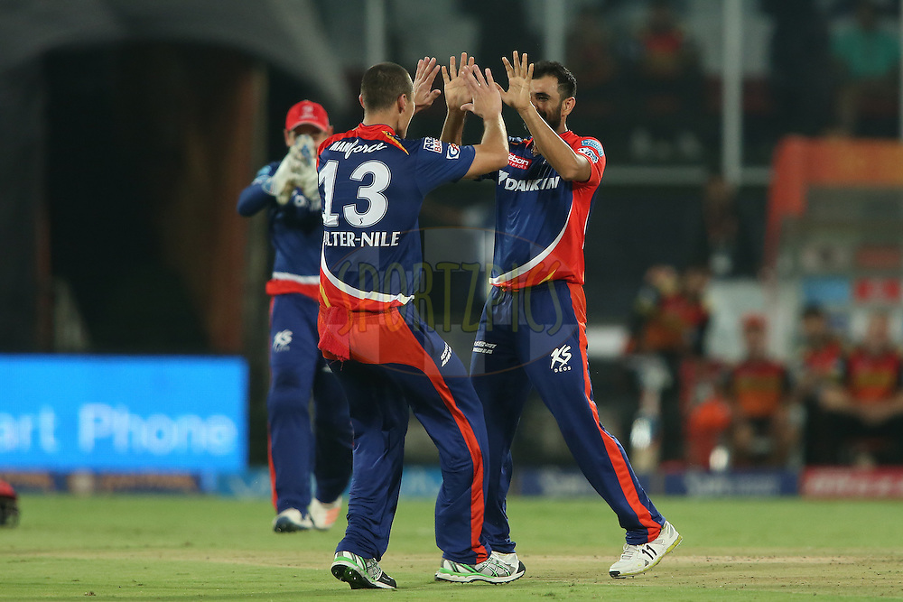 Nathan Coulter-Nile of Delhi Daredevils congratulates Mohammed Shami of Delhi Daredevils for getting Moises Henriques of Sunrisers Hyderabad wicket during match 42 of the Vivo IPL 2016 (Indian Premier League) between the Sunrisers Hyderabad and the Delhi Daredevils held at the Rajiv Gandhi Intl. Cricket Stadium, Hyderabad on the 12th May 2016<br /> <br /> Photo by Shaun Roy / IPL/ SPORTZPICS