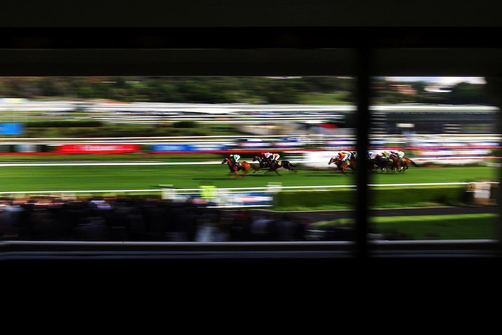 Horses cross the finish line at Randwick racecourse, Sydney , Australia.