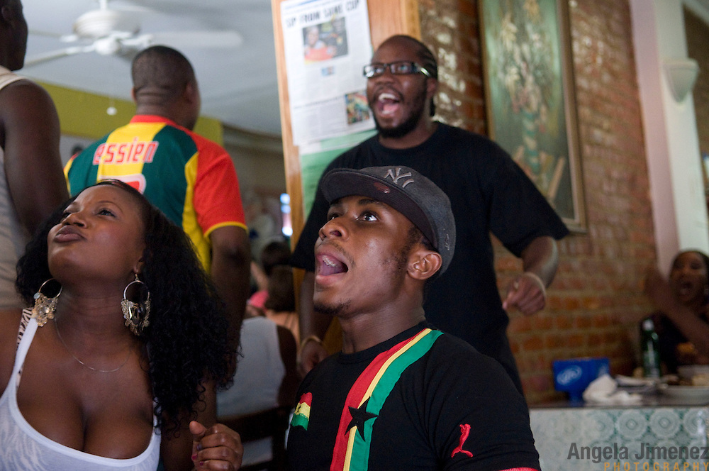Date: 6/23/10..Fans of Ghana watch their team lose a 1-0 World Cup match to Germany at the Meytex Cafe in Flatbush, Brooklyn on June 23, 2010. Ghana still advanced to the round of 16...Photo by Angela Jimenez for Newsweek.com .photographer contact 917-586-0916/angelajime@gmail.com