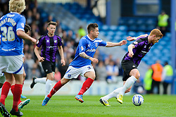 Matt Harrold (ENG) of Bristol Rovers is challenged by Rhys McCabe (SCO) of Portsmouth - Photo mandatory by-line: Rogan Thomson/JMP - 07966 386802 - 19/04/2014 - SPORT - FOOTBALL - Fratton Park, Portsmouth - Portsmouth FC v Bristol Rovers - Sky Bet Football League 2.