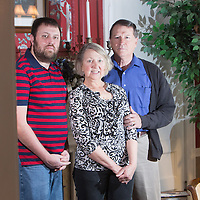 Bob Milton, Tricia Milton, and their son Sean Milton, Innkeepers at Rosehill Inn Bed and Breakfast pose for a portrait at the inn. (Jason A. Frizzelle)