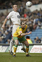 Photo: Aidan Ellis.<br /> Leeds United v Norwich City. Coca Cola Championship. 11/03/2006.<br /> Norwich's Craig Fleming is challenged by Leeds Stephen Crainey