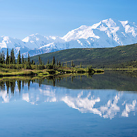 Mt. McKinley (Denali) and nearby Alaskan Range mountains reflect in the calm waters of Wonder Lake. Denali National Park, Alaska