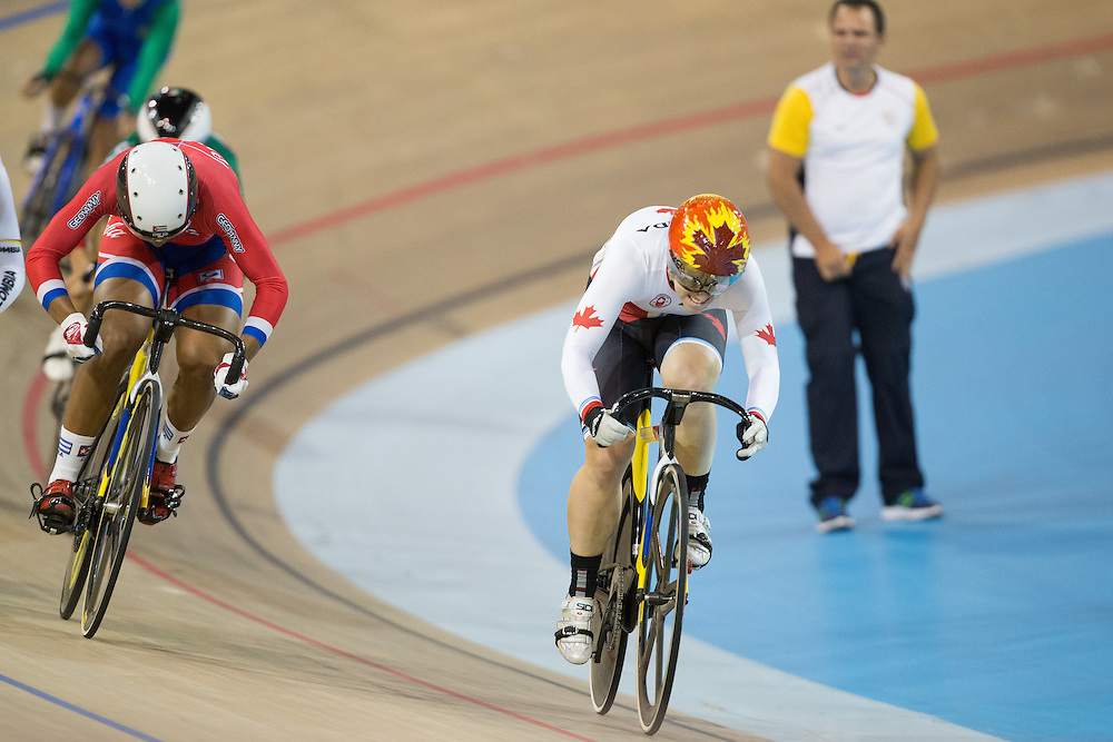 Monique Sullivan (R) of Canada rides to a gold medal win in the women's Keirin Cycling velodrome at the 2015 Pan American Games in Toronto, Canada, July 17,  2015.  AFP PHOTO/GEOFF ROBINS