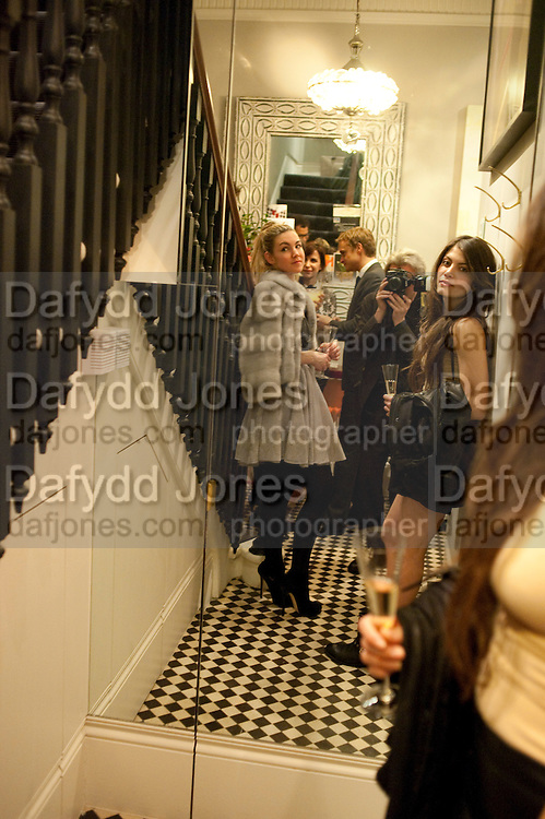 IVANA HRNJEZ; DAFYDD JONES PHOTOGRAPHING; LEILA DUPUY, Party hosted for ~Jason Wu by Plum Sykes and Christine Al-Bader. Ladbroke Grove. London. 22 March 2011. -DO NOT ARCHIVE-© Copyright Photograph by Dafydd Jones. 248 Clapham Rd. London SW9 0PZ. Tel 0207 820 0771. www.dafjones.com.