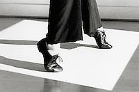Woman jazz dancing, low section (B&W, grainy)