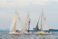 """J80's """"He's Back"""", """"Pressure"""" and """"Shamrock VI"""" sail around the buoy mark during Thursday evenings race series with the Winnipesaukee Yacht Club.   (Karen Bobotas/for the Laconia Daily Sun)"""