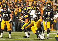 November 23 2013: Iowa Hawkeyes running back Mark Weisman (45) tucks away the ball after a catch during the first quarter of the NCAA football game between the Michigan Wolverines and the Iowa Hawkeyes at Kinnick Stadium in Iowa City, Iowa on November 23, 2013. Iowa defeated Michigan 24-21.