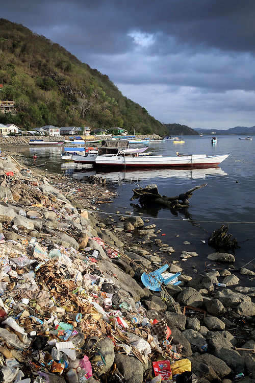 Plastic bags, bottles and other trash polluting beach in Labuan Bajo, Flores, Indonesia