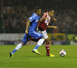 Swindon Town's Nathan Thompson carries the ball past Chelsea's Ryan Bertrand - Photo mandatory by-line: Alex James/JMP - Tel: Mobile: 07966 386802 24/09/2013 - SPORT - FOOTBALL - County Ground - Swindon - Swindon Town V Chelsea - Capital One Cup