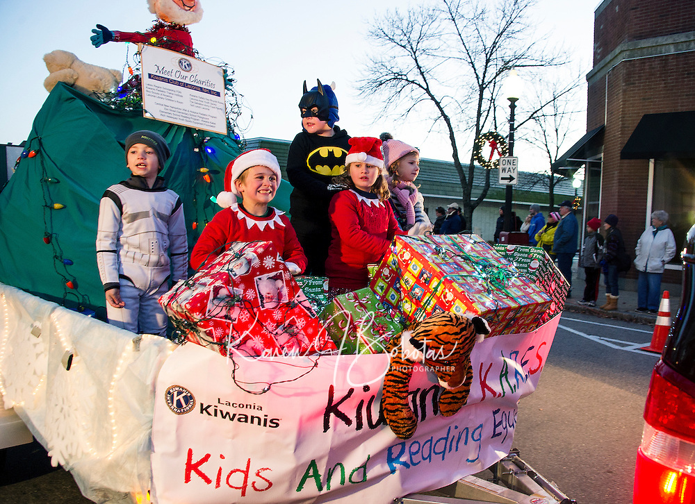 The Kiwanis Kares float makes its way down Main Street during the annual holiday parade and tree lighting ceremony in Veteran's Square on Sunday evening.  (Karen Bobotas/for the Laconia Daily Sun)