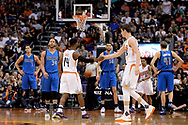 Apr 9, 2017; Phoenix, AZ, USA; Phoenix Suns guard Ronnie Price (14) and forward Dragan Bender (35) high five on the court during the first half against the Dallas Mavericks at Talking Stick Resort Arena. Mandatory Credit: Jennifer Stewart-USA TODAY Sports