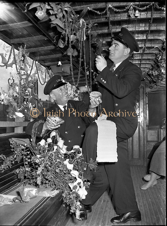 """Howth Tram. R Cannon Driver with Tom Redmond Decorating Howth Tram, 20/12/1956 """"Thanks to William Brew Nephew to Mr Cannon for giving us names"""" Christmas December 1956"""