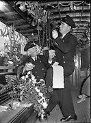 "Howth Tram. R Cannon Driver with Tom Redmond Decorating Howth Tram, 20/12/1956 ""Thanks to William Brew Nephew to Mr Cannon for giving us names"" Christmas December 1956"