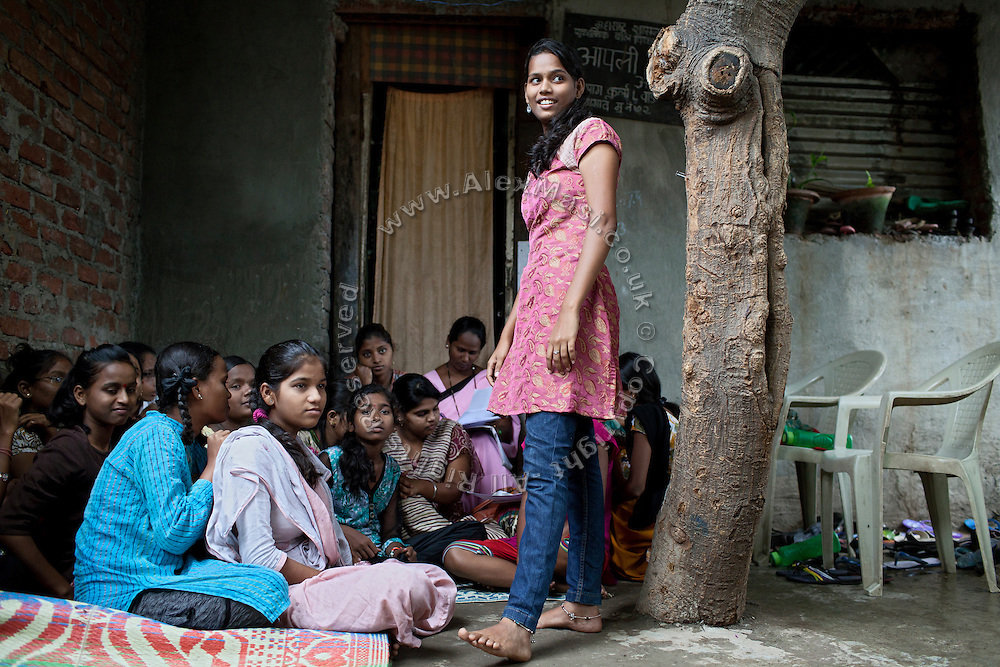 Minakshee, 17, (right) one of Mahesh Pandit's older sisters is also a Unicef community facilitator and is helping to run the Unicef-run 'Deepshikha Prerika' project inside the Milind Nagar Pipeline Area, an urban slum on the outskirts of Mumbai, Maharashtra, India, where she resides with her family.