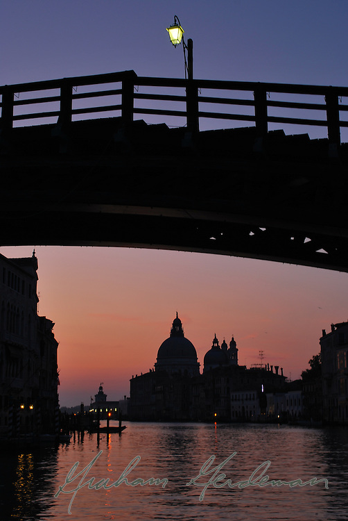 Sunrise under the Accademia bridge in Venice, Italy.