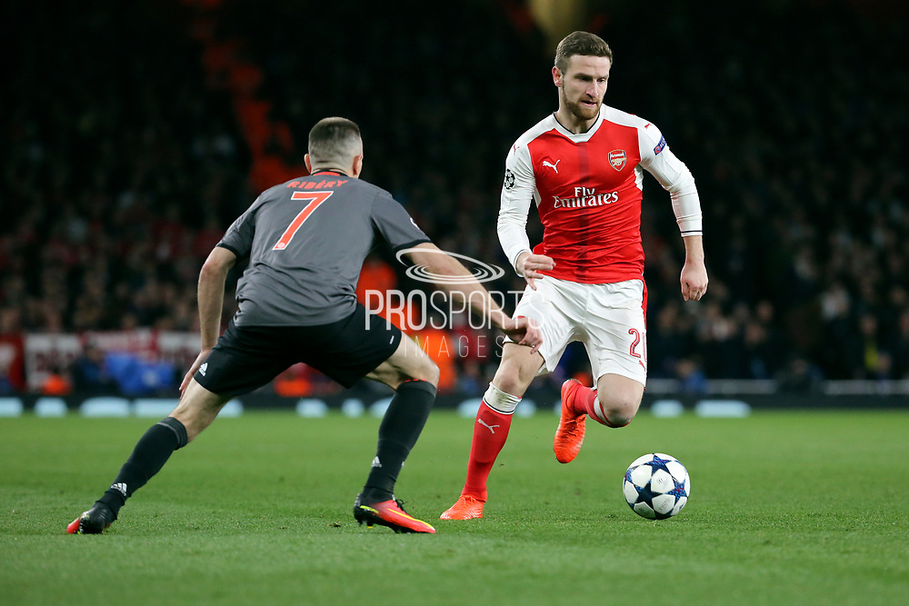 Arsenal defender Shkodran Mustafi (20) dribbling and taking on Bayern Munich attacker Frank Ribery (7) during the Champions League round of 16, game 2 match between Arsenal and Bayern Munich at the Emirates Stadium, London, England on 7 March 2017. Photo by Matthew Redman.