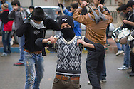 Licensed by Getty Images (2013). Available here: http://www.gettyimages.com/detail/news-photo/mourning-shia-muslim-boys-using-iron-chains-for-self-news-photo/166936233