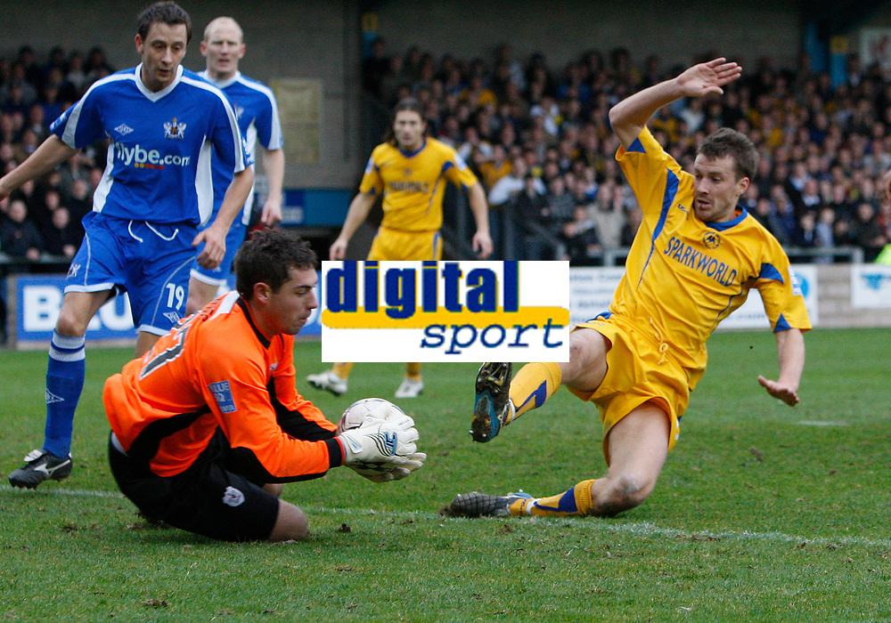 Photo: Steve Bond/Sportsbeat Images.<br />Torquay United v Exeter City. The FA Blue Square Premier. 01/01/2008. Chris Todd (R) follows up askeeper Paul Jones gathers
