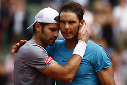 May 29, 2018 - Paris, Ile-de-France, France - Italy's Simone Bolelli (L) and  Spain's Rafael Nadal during their men's singles first round match on day three of The Roland Garros 2018 French Open tennis tournament in Paris on May 29, 2018. (Credit Image: © Mehdi Taamallah/NurPhoto via ZUMA Press)