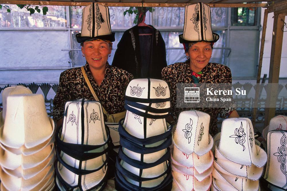 Kyrgyz women selling felt hats at the market, Osh, Kyrgyzstan