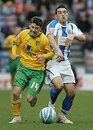 Huddersfield - Saturday, March 13th, 2010: Gary Roberts of Huddersfield Town in action against Wesley Hoolahan of Norwich City during the Coca Cola League One match at the Galpharm Stadium, Huddersfield. (Pic by Michael Sedgwick/Focus Images)