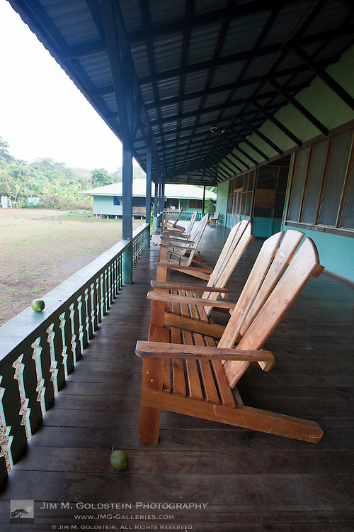 Empty deck chairs and tropical fruit at Sirena Biological Station,  Corcovado National Park, Costa Rica
