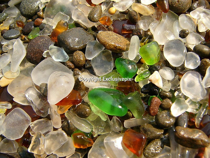 Fantastic Glass Beach of California<br /> <br /> Usually when a person throws out litter he/she influences the nature in a negative way. Heaps of litter are not useful, they spoil not only the air, soil and water but also harm the aesthetic look of the natural beauty. Could you ever think of any exceptions to this rule?There is one interesting place - Glass Beach, Fort Bragg, California, USA. This place is amazing. In the 60s the junkyard was closed and the litter just lived its life. Heaps of broken glass, plastic and other litter were just lying under the California sun washed by the sea waves and blown by the sea breezes.<br /> <br /> Eventually by the 80s it was noticed that not a trace remained from the junkyard. All the glass on the beach turned into amazing beautiful bright and translucent stones under the impact of the waves. From that time and on more and more tourists began to come here, this place has become very popular. There are many masters who make various souvenirs from these stones that sell rather well. It's a great wonder of the industrial interference of humans in the natural processes.<br /> &copy;Exclusivepix