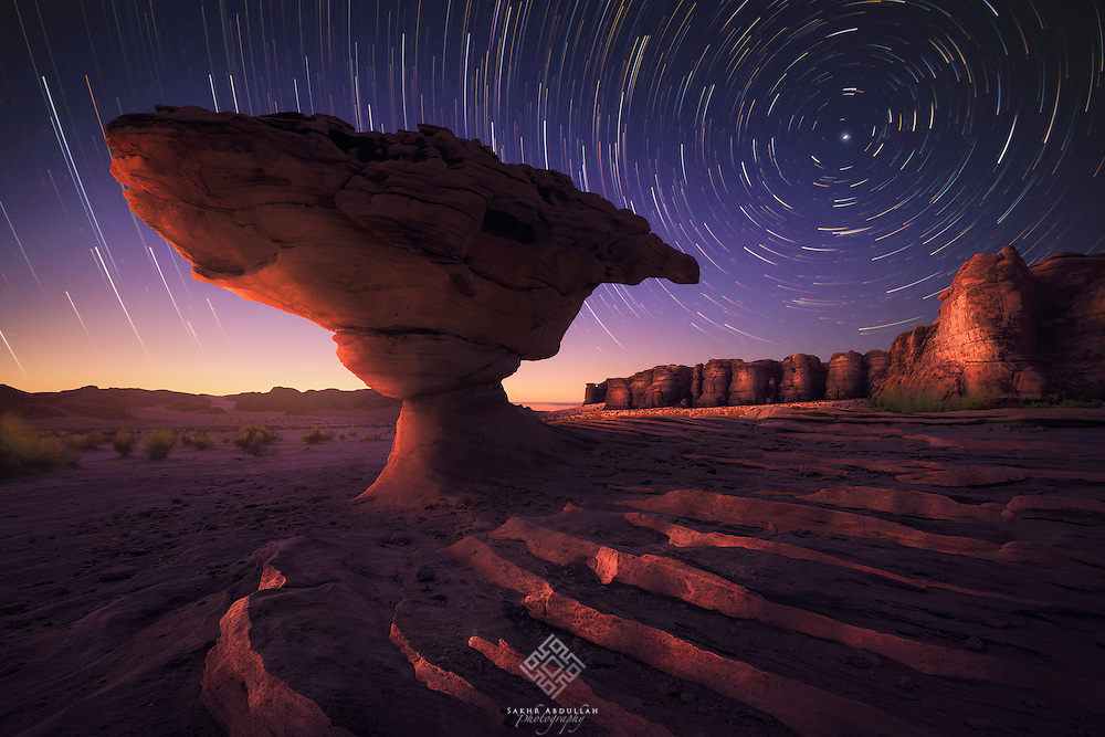 In the north of Saudi Arabia, many beautiful rocks formations are take place with different shapes. At the time, I would have loved if it was cloudy, but unfortunately, it was clear. When I saw this rock, I was interested with all area around. so I got the idea to capture the star trails at the north side.