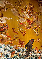 Detail of a dragon battle scene on a beautiful painted ceiling of a temple in Singapore, Asia.
