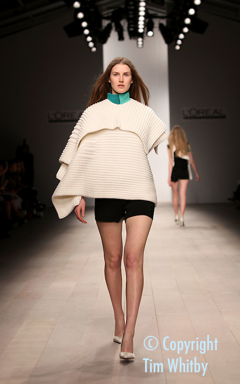 LONDON, ENGLAND - FEBRUARY 17:  A model walks the runway during the Central Saint Martins MA Fashion show featuring student designer Mei Lim-Cooper at London Fashion Week Autumn/Winter 2012 at Somerset House on February 17, 2012 in London, England  (Photo by Tim Whitby/Getty Images)