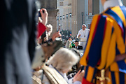 Pope Francis arrives in St. Peter's Square for his weekly general audience, at the Vatican, Wednesday, March 14, 2018.
