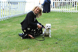 INGRID SEWARD and her dog Puff at the Macmillan Dog Day in aid of Macmillan Cancer Support held at the Royal Hospital Chelsea, London on 8th July 2008.<br />