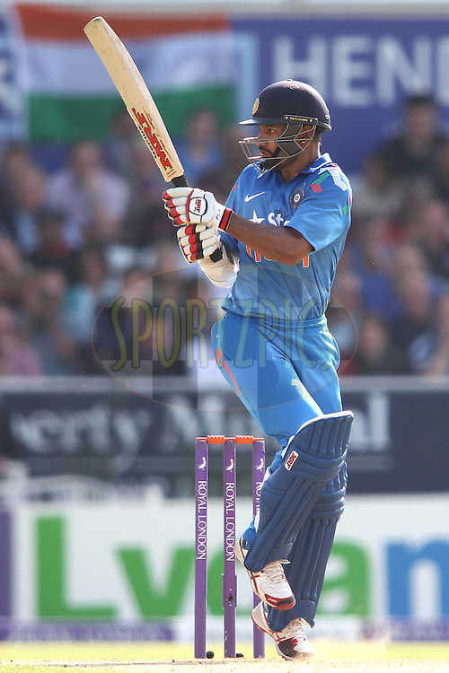 Shikhar Dhawan of India pulls a delivery during the 5th One Day International ( ODI ) match between England and India held at Headingley Cricket Ground in Leeds, England on the 5th September 2014<br /> <br /> Photo by Shaun Roy / SPORTZPICS/ BCCI