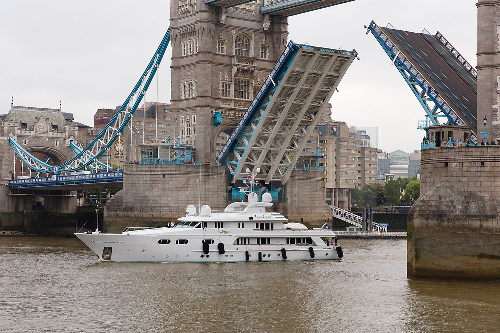 © Licensed to London News Pictures. 16/05/2018. London, UK. Superyacht, Lady M II passes under Tower Bridge this morning before mooring next to HMS Belfast. The 164 feet long superyacht, Lady M II (previously named Lady M) is rumoured to be owned by politician and businessman, Lord Ashcroft. A different superyacht, called Lady M visited Glasgow and Cumbria last year and was reported to be owned by Russia's richest Billionaire, Alexi Mordashov. Lady M II sleeps up to 11 guests in 6 rooms and is also capable of carrying up to 12 crew onboard. Lady M II was designed by Donald Starkey with various luxuries onboard, including a deck jacuzzi and is advertised for charter at USD180,000 per week plus expenses. Photo credit: Vickie Flores/LNP