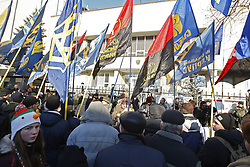 February 5, 2018 - Kiev, Ukraine - Ukrainian nationalists from ''Freedom'' party attend a protest near the Polish Embassy in Kiev, Ukraine, 05 February,2018. They protest against the bill about 'Bandera ideology'. Polish Sejm on 26 January voted for the bill setting a ban on promoting the so-called 'Bandera ideology,' with its historic roots stemming from Ukraine. The law also introduces criminal liability for those asserting that the Poles were collaborating with the Nazis during World War II. Ukrainian President Poroshenko believes that the law does not correspond with the proclaimed principles of strategic partnership between the two countries, as local media reported. (Credit Image: © Str/NurPhoto via ZUMA Press)