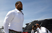 Apr 6, 2018; Thousand Oaks, CA, USA; Los Angeles Rams defensive tackle Ndamukong Suh arrives at a press conference as photographer Jeff Lewis takes photos at Cal Lutheran.