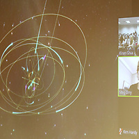Dr. Meg Urry, a Physics professor at Yale, explains a diagram of stars orbiting around a black hole to a group of Mississippi high School students during their lesson through video-conference Monday afternoon at Mississippi State University. The students are taking AP summer prep courses preparing them forupcoming AP Physics this school year.