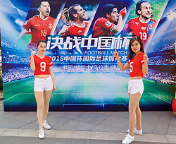 NANNING, CHINA - Thursday, March 22, 2018: Local Wales supporters pose for a photograph with Wales branding at the Nanning Wanda Mall ahead of the 2018 Gree China Cup International Football Championship match between China and Wales. (Pic by David Rawcliffe/Propaganda)