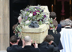 A wicker basket coffin with the hat of Only Fools and Horses actor  Roger Lloyd-Pack who played Trigger in the TV show , arriving at St.Paul's Church in  London, Thursday, 13th February 2014. Picture by Stephen Lock / i-Images
