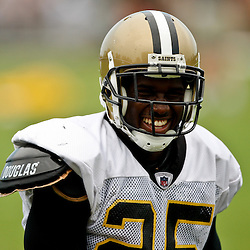 August 3, 2010; Metairie, LA, USA; New Orleans Saints running back Reggie Bush (25) laughs with a teammate following a training camp practice at the New Orleans Saints practice facility. Mandatory Credit: Derick E. Hingle