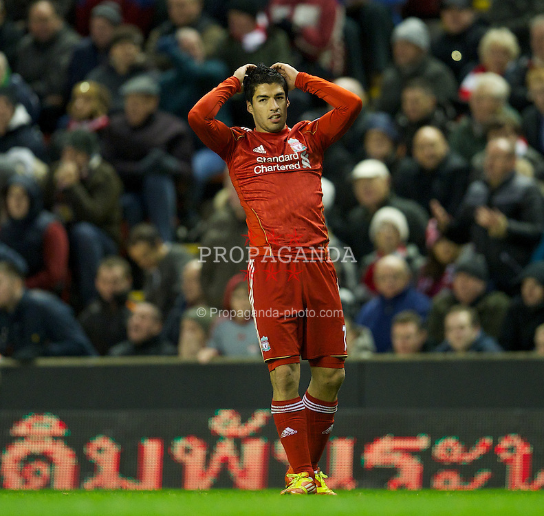 LIVERPOOL, ENGLAND - Saturday, December 10, 2011: Liverpool's Luis Alberto Suarez Diaz looks dejected during the Premiership match against Queens Park Rangers at Anfield. (Pic by David Rawcliffe/Propaganda)