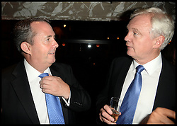 DR Liam Fox (L) and David Davies talk at The InterContinental Westminster  Political Party. London, United Kingdom. Wednesday, 11th September 2013. Picture by Andrew Parsons / i-Images