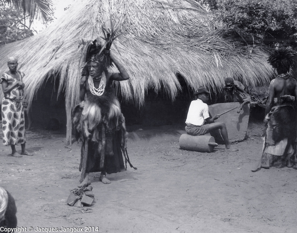 Luba traditional diviners (medicine men) dancing to he sound of slit drum, Kaluanzo, Katanga Province, then Belgian Congo, now Democratic Republic of the Congo (1959)