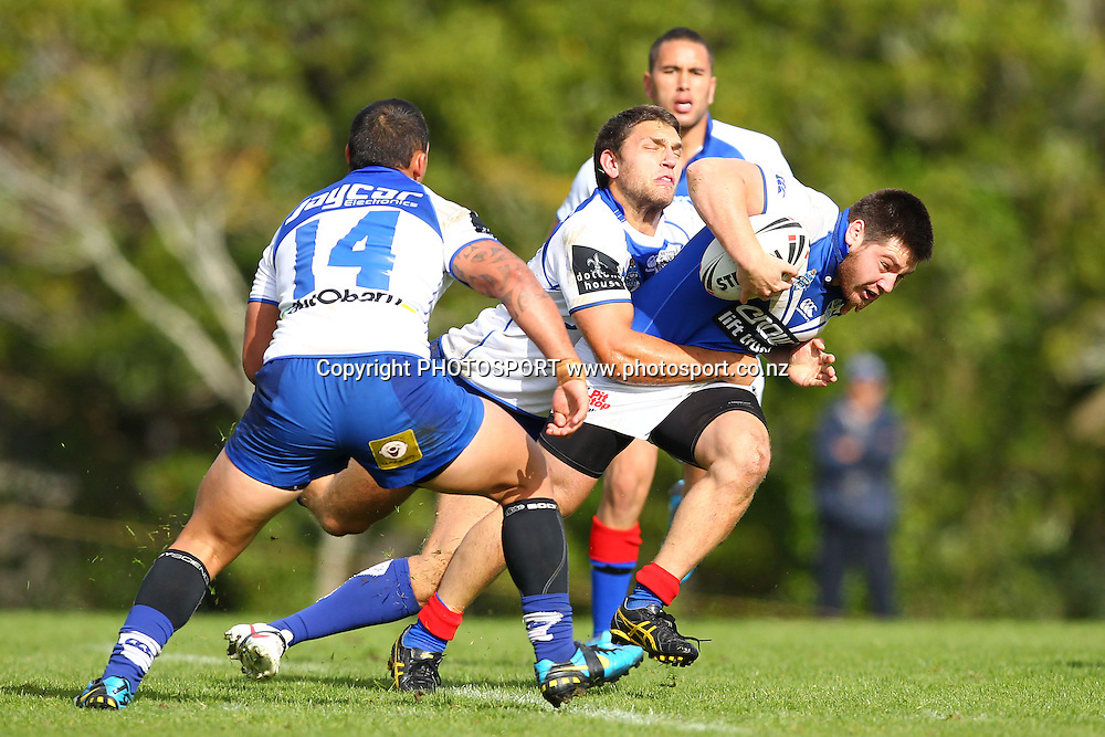 Trent Bishop is tackled during a NSW Cup rugby league game, Auckland Vulcans v Canterbury Bankstown Bulldogs, Birkenhead War Memorial, Auckland, New Zealand. Saturday 19 May, 2012. Photo: Wayne Drought / photosport.co.nz