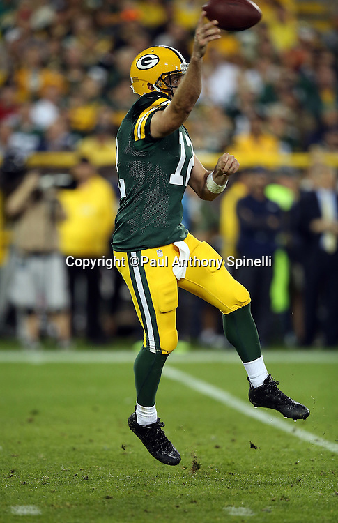 Green Bay Packers quarterback Aaron Rodgers (12) jumps off his feet and throws a second quarter pass during the 2015 NFL week 3 regular season football game against the Kansas City Chiefs on Monday, Sept. 28, 2015 in Green Bay, Wis. The Packers won the game 38-28. (©Paul Anthony Spinelli)