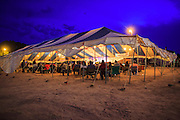 "12 JULY 2012 - FT DEFIANCE, AZ:  The main tent at the 23rd annual Navajo Nation Camp Meeting in Ft. Defiance, north of Window Rock, AZ, on the Navajo reservation. Preachers from across the Navajo Nation, and the western US, come to Navajo Nation Camp Meeting to preach an evangelical form of Christianity. Evangelical Christians make up a growing part of the reservation - there are now more than a hundred camp meetings and tent revivals on the reservation every year. The camp meeting in Ft. Defiance draws nearly 200 people each night of its six day run. Many of the attendees convert to evangelical Christianity from traditional Navajo beliefs, Catholicism or Mormonism. ""Camp meetings"" are a form of Protestant Christian religious services originating in Britain and once common in rural parts of the United States. People would travel a great distance to a particular site to camp out, listen to itinerant preachers, and pray. This suited the rural life, before cars and highways were common, because rural areas often lacked traditional churches.    PHOTO BY JACK KURTZ"
